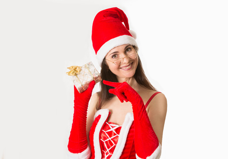 clause: Attractive woman smiling portrait in Santa Clause costume Stock Photo