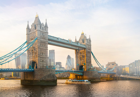 night dusk: LONDON, UK - SEPTEMBER 19, 2015: Tower bridge and City of London at dusk and first night lights. View includes Gherkin and other buildings at the background Editorial