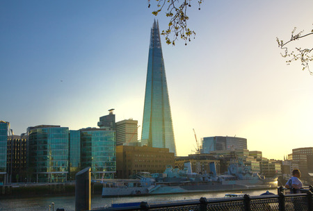 sunset city: LONDON, UK - APRIL 15, 2015:  City of London and Shard of glass building. View from the South bank of the river Thames at sunset. Editorial