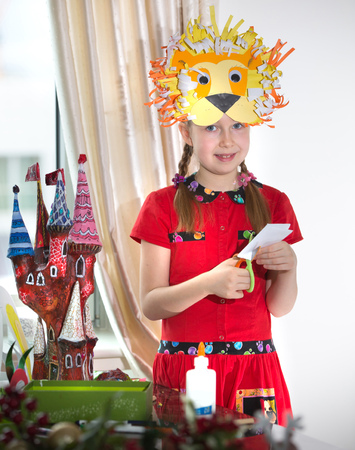 art and craft: Little girl demonstrating her art craft work, Paper masher fairy castle she made. Educational and creative concept.