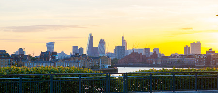 night dusk: City of London view at dusk. Modern business and banking aria with first night lights and River Thames Stock Photo