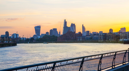 LONDON, UK - OCTOBER 17, 2014: City of London business and banking aria at sunset Editorial