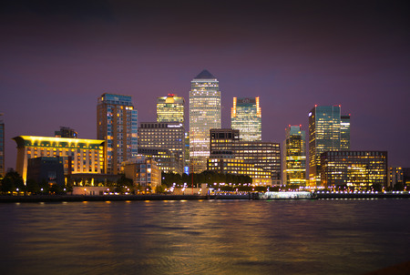 darck: LONDON, UK - OCTOBER 17, 2014: Canary Wharf business and banking aria and first night lights