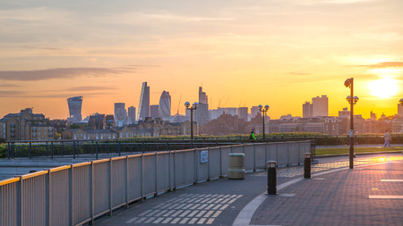 London, UK - May 21, 2015: City of London view at dusk. Modern business and banking aria with first night lights and River Thames Editorial