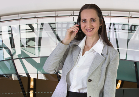 office environment: Attractive woman with headset portrait in office environment Stock Photo