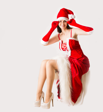 clause: Attractive woman in Santa Clause outfit . Christmas background Stock Photo
