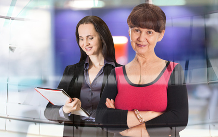 good looking woman: Two good looking woman working in the office