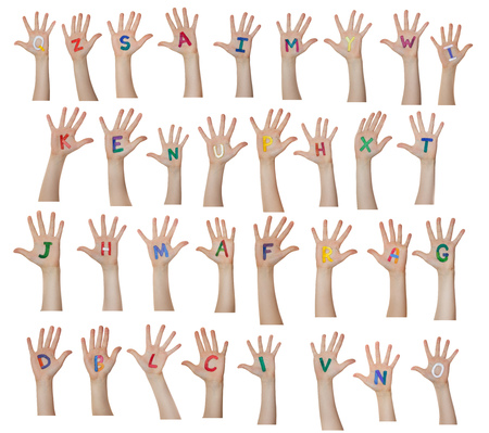 children background: Alphabet (letters) painted on children hands. Rises up hands. Stock Photo