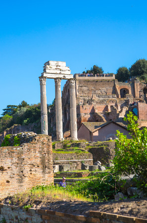 ROME, ITALY - APRIL 8, 2016: Ruins and Columns the Temple of Castor and Pollux Romans forum with ruins of important ancient government buildings started 7th century BC