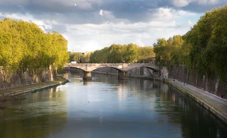 st peter s square: ROME, ITALY - APRIL 8, 2016:  river Tiber view and Roman bridge