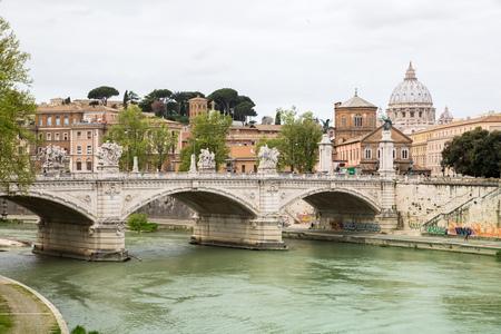 beatification: ROME, ITALY - APRIL 8, 2016: St Peters basilica in Vatican, river Tiber view and Roman bridge Stock Photo
