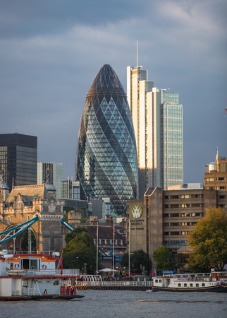 LONDON, UK - SEPTEMBER 19, 2015: City of London with first night lights at sunset. Modern business and banking aria. Editorial
