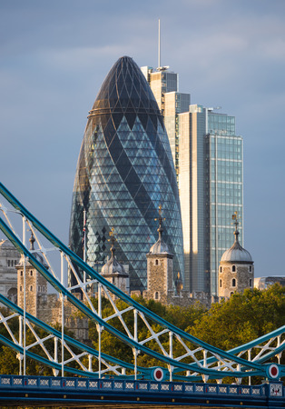 sunset city: LONDON, UK - SEPTEMBER 19, 2015: City of London with first night lights at sunset. Modern business and banking aria. Editorial