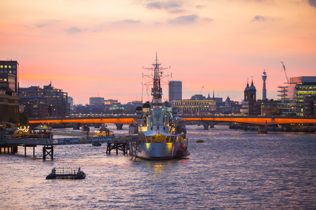 LONDON, UK - SEPTEMBER 19, 2015: City of London, Belfast ship and River Thames at sunset. Editorial