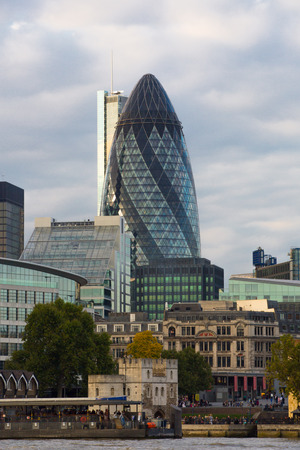 LONDON, UK - SEPTEMBER 19, 2015:  Gherkin building. View from the embankment at sunset
