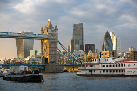 riverbank: LONDON, UK - SEPTEMBER 19, 2015: Tower bridge and Gherkin building. View from the embankment at sunset