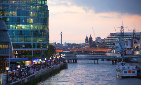 LONDON, UK - SEPTEMBER 20, 2015: Thames embankment with lots of walking people and tourists Editorial