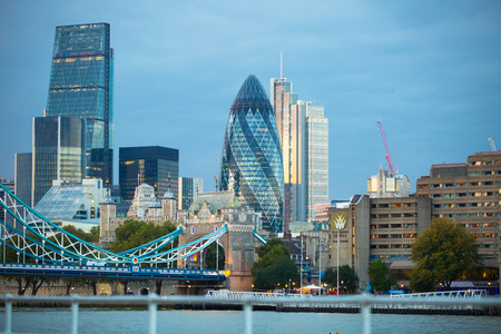river banks: LONDON, UK - SEPTEMBER 19, 2015: City of London with first night lights at sunset. Modern business and banking aria. View from the Tower bridge include Gherkin building Editorial