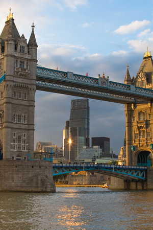 LONDON, UK - SEPTEMBER 19, 2015: City of London with first night lights at sunset. Modern business and banking aria. View from the Tower bridge include Walkie-Talkie Editorial