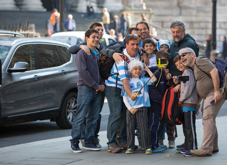 LONDON, UK - SEPTEMBER 20, 2015: Family making a selfie and the Londons street. Boys day out Editorial