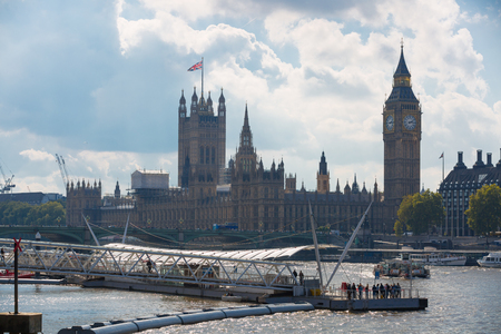 riverbank: LONDON, UK - SEPTEMBER 20, 2015: Centre of London view from the Thames embankment. Big Ben, Parliament