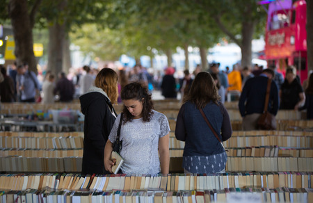 southbank: LONDON, UK - SEPTEMBER 20, 2015: People looking for book bargain in The Southbank Centres Book Market