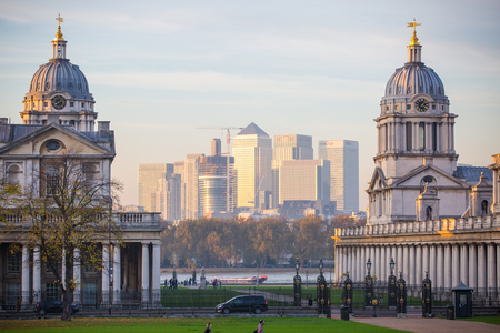 greenwich: LONDON, UK - OCTOBER 31, 2015: Panorama of Canary Wharf at twilight. View from the Greenwich