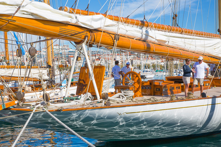 sailing boats: CANNES, FRANCE - 19 SEPTEMBER, 2016: Vieux Port (old port) in the city of Cannes, with lots of sailing boats and power yachts anchored during the Sailing regatta