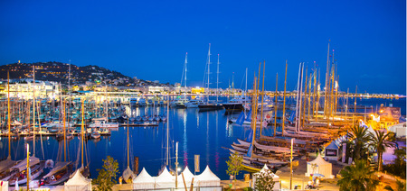 super yacht: CANNES, FRANCE - 19 SEPTEMBER, 2016:   Old Port Vieux Port in the city of Cannes at night. Lots of sailing boats and power yachts anchored during the Sailing regatta.