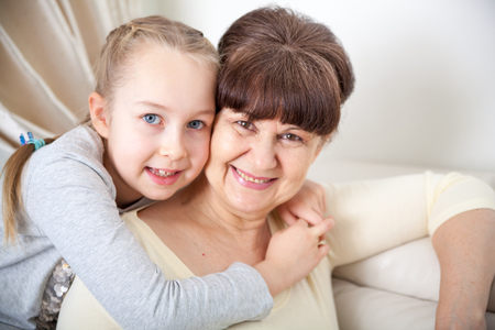 Senior lady with granddaughter happy together in domestic environment Stock Photo