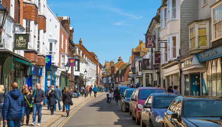 rye: RYE, UK - 1 MAY, 2016: High street of Old Rye town with periodic buildings, lots of people and cars parked on side. Editorial