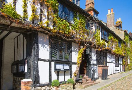 rye: RYE, UK - 1 MAY, 2016: Old street of Rye town with periodic buildings. Mermaid inn