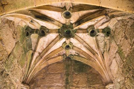 gatehouse: BODIAM, UK - 1 MAY, 2016:  Murder-holes in the gatehouse of Bodiam Castle Bodiam Castle