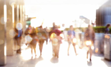Business people walking in the City, blurred image with lights reflection. Business and modern life concept Stock Photo