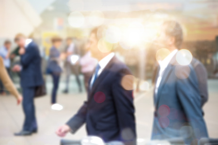 blurred: Business people walking in the City, blurred image with lights reflection. Business and modern life concept Stock Photo