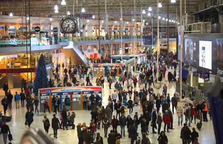 lots people: LONDON UK - 19 DECEMBER, 2015: Waterloo international train station in the centre of London, one of the main rail junction of Great Britain Departure hall with lots of people