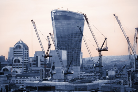 LONDON, UK - DECEMBER 19, 2016: London at sunset, Walkie-Talkie building and lots of cranes showing busy construction side of the modern capital