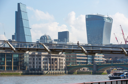 LONDON UK - SEPTEMBER 10, 2015 - City of London modern business aria view from the London Bridge. Editorial