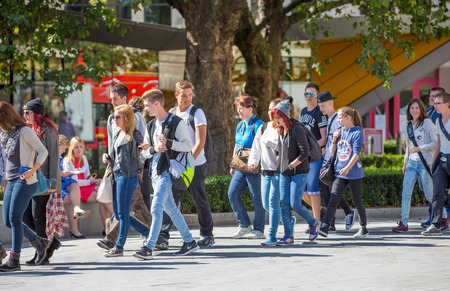 office life: LONDON, UK - SEPTEMBER 10, 2015: Office workers and people walking in the st. Pauls cathedral park in lunch time. City of London business life