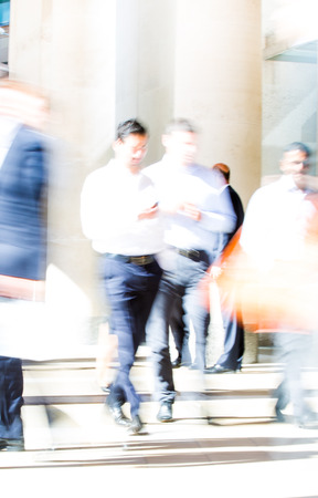 blurred people: Business people blur. People walking in the City of London, business and financial aria