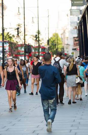 main street: LONDON, UK -  August 24, 2016: Lots of people walking in Oxford street, one of the main shopping destination of London Editorial