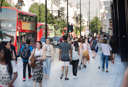 lots people: LONDON, UK -  August 24, 2016: Lots of people walking in Oxford street, one of the main shopping destination of London Editorial