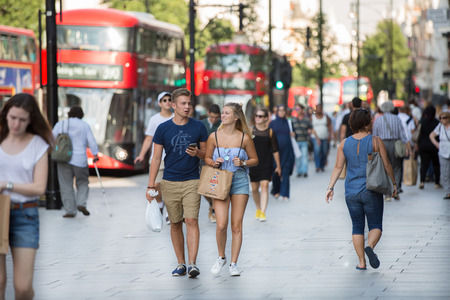 many people: LONDON, UK -  August 24, 2016: Lots of people walking in Oxford street, one of the main shopping destination of London Editorial