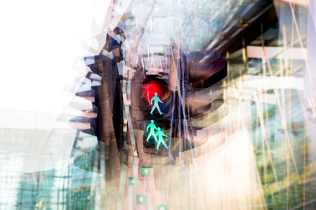 traffic building: Multiple exposure effect image. Traffic light showing red against of modern office block building.  Business and modern life concept. Stock Photo