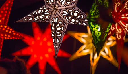 christmas stars: London, UK - December 19, 2015: Christmas lights decorations at Southwark open market in London. Christmas background