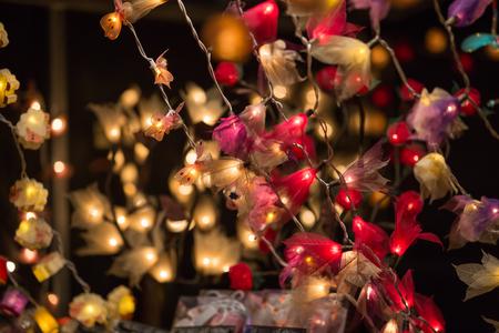 London, UK - December 19, 2015: Christmas lights decorations at Southwark open market in London. Christmas background