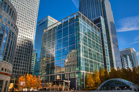office buildings: LONDON, UK - November 16, 2016: Canary Wharf business and banking aria at sunny day. Main square view with glass skyscrapers
