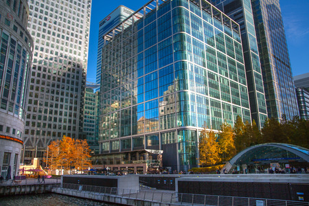 office building: LONDON, UK - November 16, 2016: Canary Wharf business and banking aria at sunny day. Main square view with glass skyscrapers