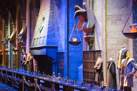great hall: Leavesden, London, UK - 1 March 2016: Interior of the Great Hall (Dining Hall) of Hogwarts. Fire place and table. Warner Brothers Studio display of decorations for Harry Potter film Editorial