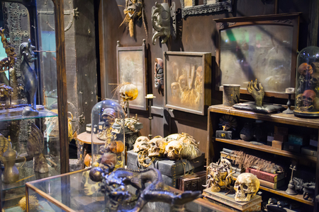 alley: Leavesden, London, UK - 1 March 2016: Magic shops  windows display in Diagon Alley from Harry Potter film. Warner Brothers Studio Editorial